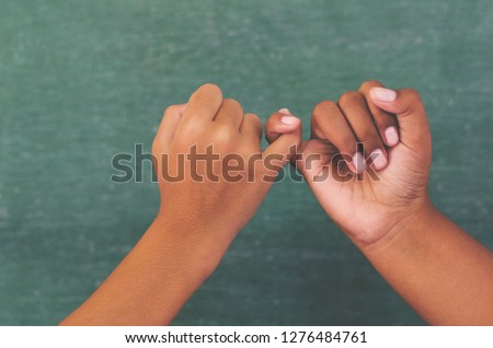 Hand to pinky swear,Happy couple or friendship holding hands together forever love concept. #1276484761