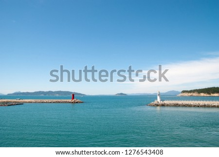 Republic of Korea, Jeollanam-do Wando-gun Cheongsando Island is facing the red lighthouse and the white lighthouse of the breakwater. #1276543408