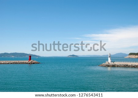 Republic of Korea, Jeollanam-do Wando-gun Cheongsando Island is facing the red lighthouse and the white lighthouse of the breakwater. #1276543411