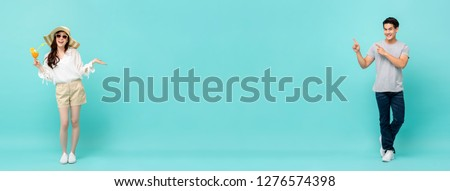 Young casual happy Asian man and woman on light blue long banner background with copy space #1276574398