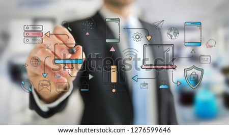 Businessman on blurred background drawing tech devices and icons thin line interface #1276599646