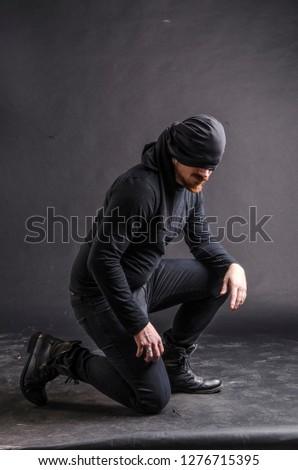 Portrait of a masked super hero on black background. #1276715395