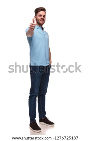 relaxed casual man in polo shirt makes ok sign while standing on white background with a hand in pocket, full length picture