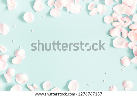 Flowers composition. Rose flower petals on pastel blue background. Valentine's Day, Mother's Day concept. Flat lay, top view, copy space #1276767157