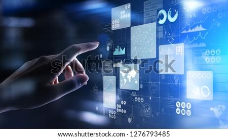 Business intelligence analyst dashboard on virtual screen. Big data Graphs Charts. #1276793485