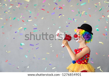 Funny kid clown. Happy child playing at home. 1 April Fool's day concept #1276854901