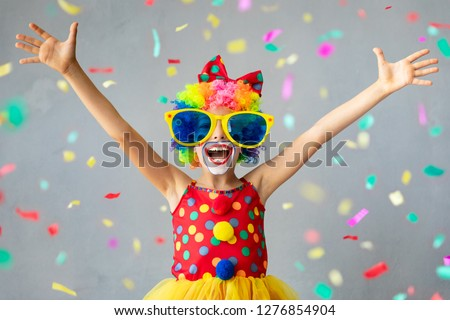 Funny kid clown. Happy child playing at home. 1 April Fool's day concept #1276854904