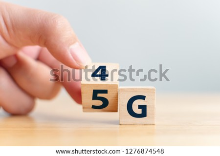 5G (5th Generation) network connecting technology future global. Hand flip wood cube change number 4G to 5G