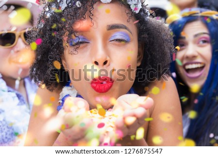 Carnaval party. Dressed group of Brazil people in the city Carnival. Brazilian woman in costume celebrating in parade festival. #1276875547