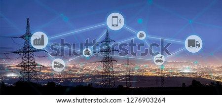 High power electricity poles connected to smart grid. Energy supply, distribution of energy, transmitting energy, energy transmission, high voltage supply concept photo, smart grid, smart home #1276903264