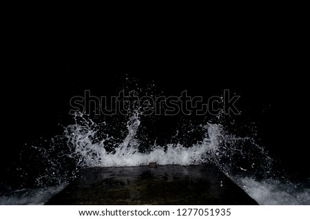 Splashing wave on the Black sea in the night. #1277051935