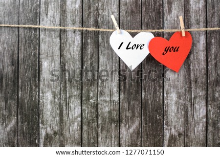 Red and white Valentine's hearts on a dark wooden background. Festive concept. #1277071150