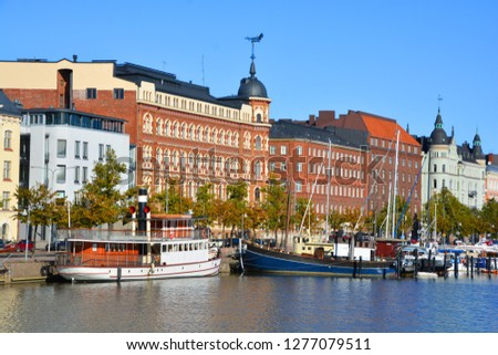 HELSINKI FINLAND 09 25 2015: Pohjoisranta is located in center and runs along northern harbor. On waterfront there are houses built in different architectural styles in different historical periods #1277079511