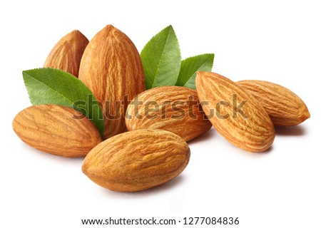 Close-up of almonds with leaves, isolated on white background #1277084836