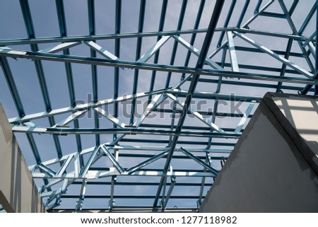 Structure of steel roof frame for building construction isolated on blue sky background. #1277118982