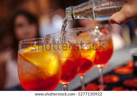 Bartender pours water into a glass with a cocktail. Barman making a cocktail. Close-up #1277130922