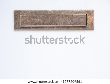 Old bronze mailbox. Brass vintage mail letter box on white color wall background. Closeup view with details #1277209561
