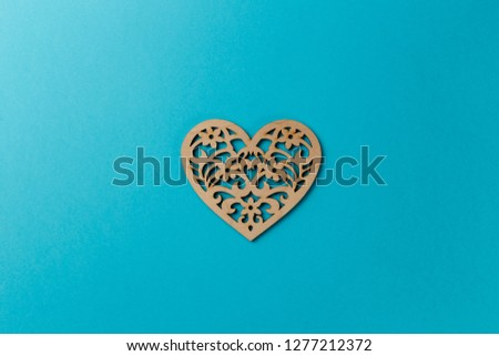 Valentine's Day postcard. Wooden heart on blue background. Copy space. Top view. Flat lay. Pastel colors #1277212372