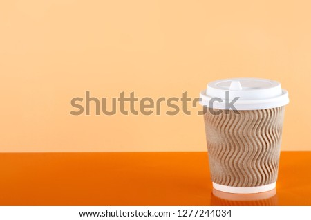 Cardboard cup of coffee on orange background #1277244034
