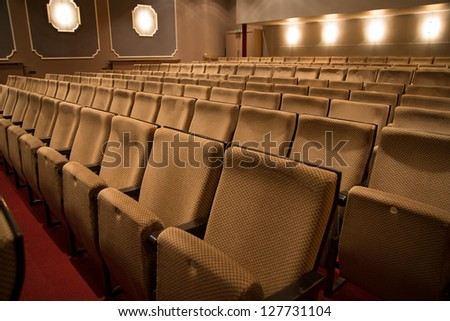 Seat rows in an theater without audience #127731104