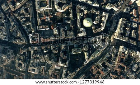 Aerial top down view of the city streets and houses pattern in the centre of Milan, Italy Royalty-Free Stock Photo #1277319946