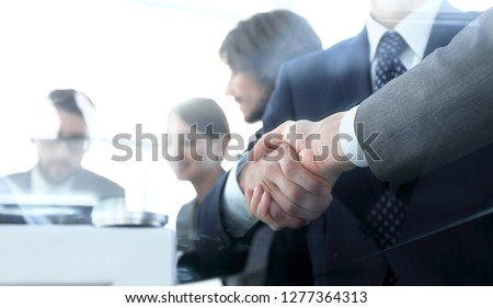 handshake of business partners in conference room #1277364313