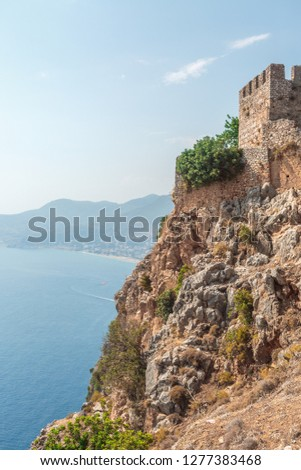 Fragment of the ancient fortress wall of Alanya castle overlooking the sea and the beach. Turkey #1277383468