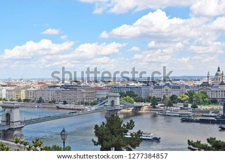 BUDAPEST, HUNGARY - JULY 21, 2017: The view from the hill to the chain bridge in Budapest leading to the Grachem hotel and the basilica across the Danube river. General panorama of the city  #1277384857
