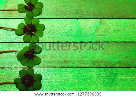 lucky clover on green boards #1277396305