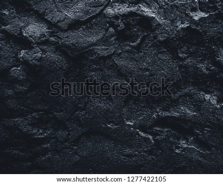 Black texture. Stone black wall. Rock texture. Stone background. Black background. Stone texture. Rock pile background. Rough structure mineral #1277422105