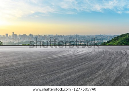 Panoramic city skyline and buildings with empty asphalt road at sunrise #1277505940