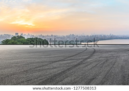 Panoramic city skyline and buildings with empty asphalt road at sunrise #1277508313