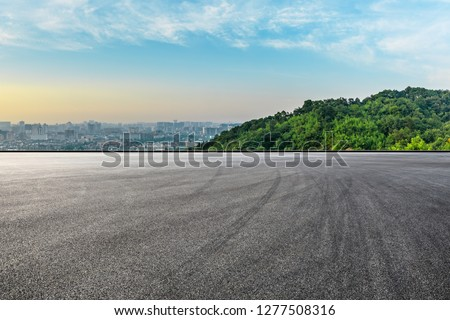 Panoramic city skyline and buildings with empty asphalt road at sunrise #1277508316