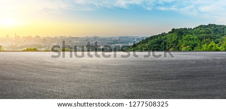 Panoramic city skyline and buildings with empty asphalt road at sunrise Royalty-Free Stock Photo #1277508325