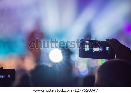 Use advanced mobile recording, fun concerts and beautiful lighting, Candid image of crowd at rock concert, Close up of recording video with smartphone, Enjoy the use of mobile photography #1277520949