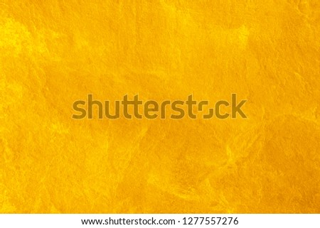 gold color wall for background. #1277557276