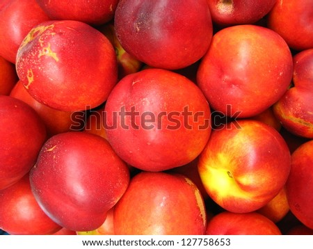 the image of a lot of red nectarines