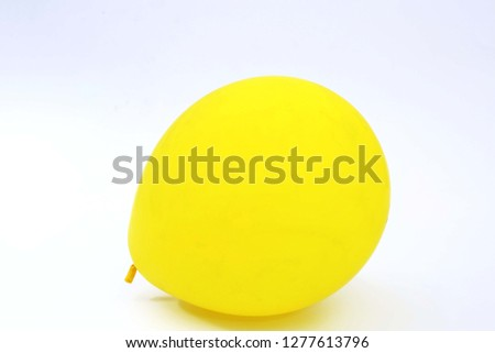 Picture of yellow balloon. Isolated on the white background. #1277613796