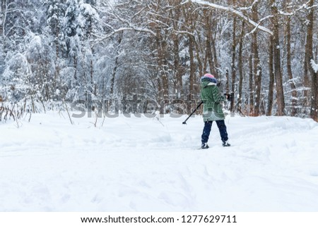 Woman walk in the winter wood. Snow-covered landscape #1277629711