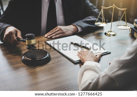 Good service cooperation, Consultation of Businesswoman and Male lawyer or judge counselor having team meeting with client, Law and Legal services concept. #1277666425