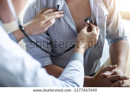 Doctor using a stethoscope checking patient with examining, presenting results symptom and recommend treatment method, Healthcare and medical concept. #1277667640