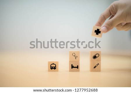 Hand arranging wood block stacking with icon healthcare medical, health concept #1277952688