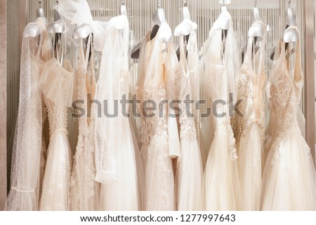 Large selection of dresses in the wedding salon.  #1277997643