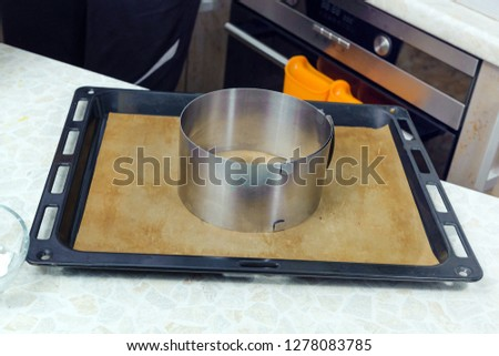 Metal baking pan on the baking tray #1278083785
