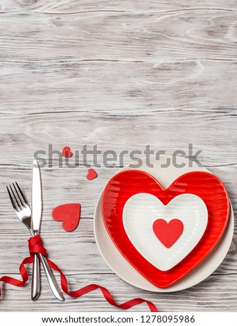 Dinner table with plate. Love concept for mother's day and valentine's day. Valentine. Love postcard. Happy Valentine's day hearts on wooden background. Valentine card with space for text #1278095986