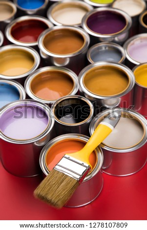 Collection of colored paints cans, Brush, red background #1278107809