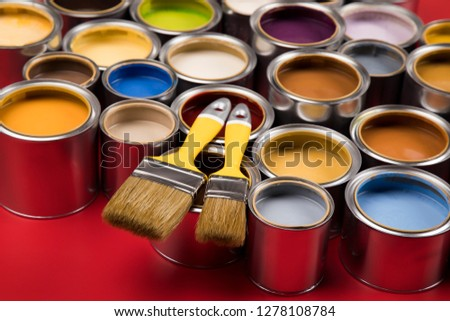 Open buckets with a paint and brush, red background #1278108784