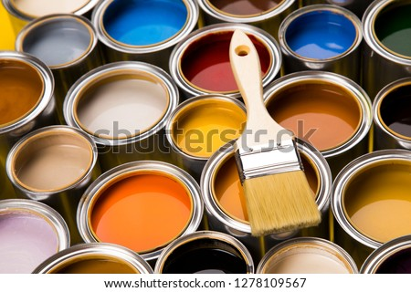 Metal tin cans with color paint and paintbrush #1278109567