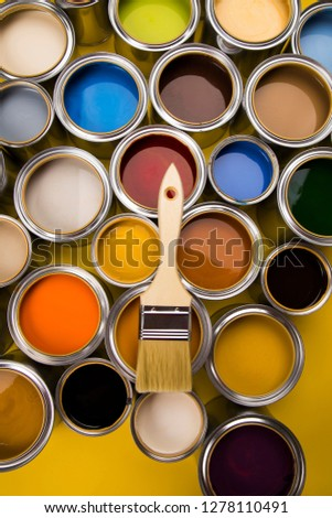 Metal tin cans with color paint and paintbrush #1278110491