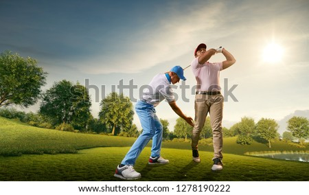 Male golf players on professional golf course. Golfer teaches to play golf #1278190222